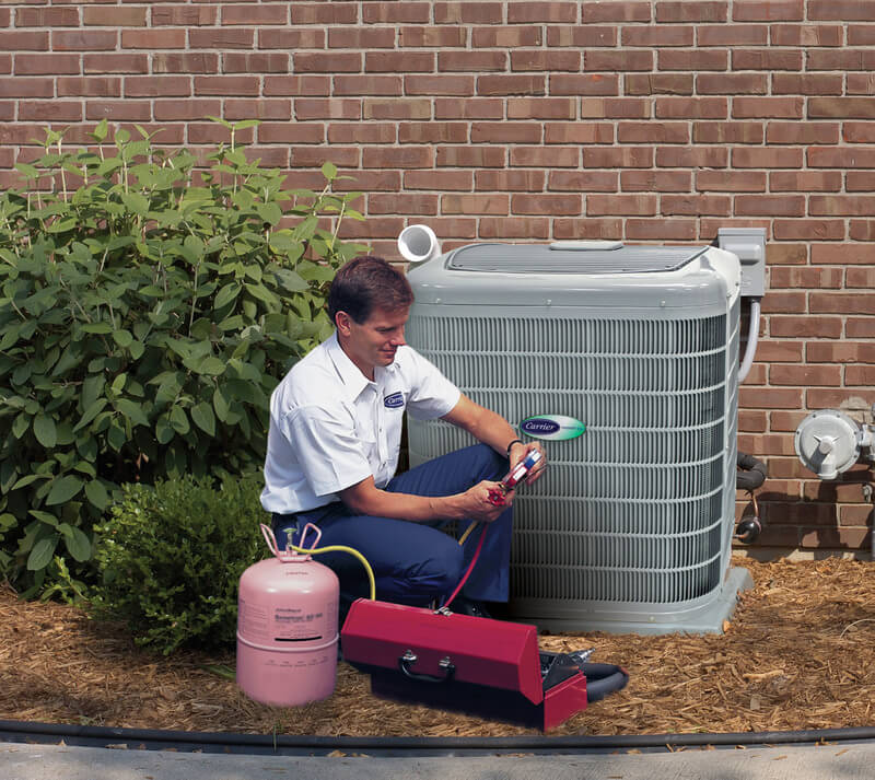 HVAC tech performing maintenance on an air conditioner unit in Fort Worth, TX