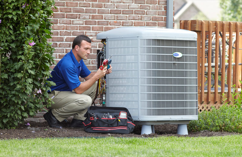 HVAC tech performing repairs on an air conditioner unit in Fort Worth, TX